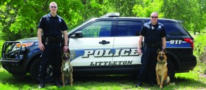 Officer Brent Kieffer with K-9 Sabor is on the left, and Officer John Jones with K-9 Koda is on the right.